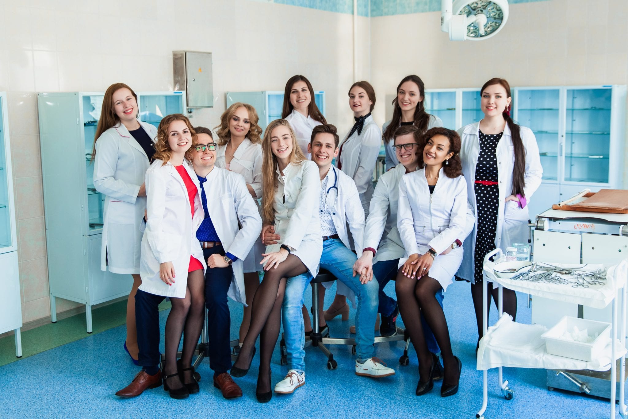 Education and health. general practitioner. A group of smart medical students in college. Friends interns in the surgery room in white coats. Team work at the university.