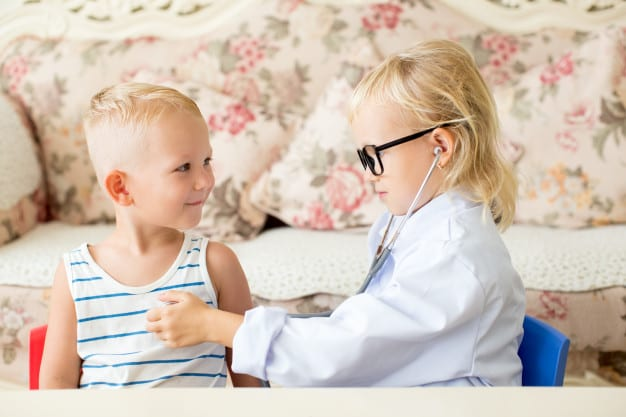 serious little doctor examining patients